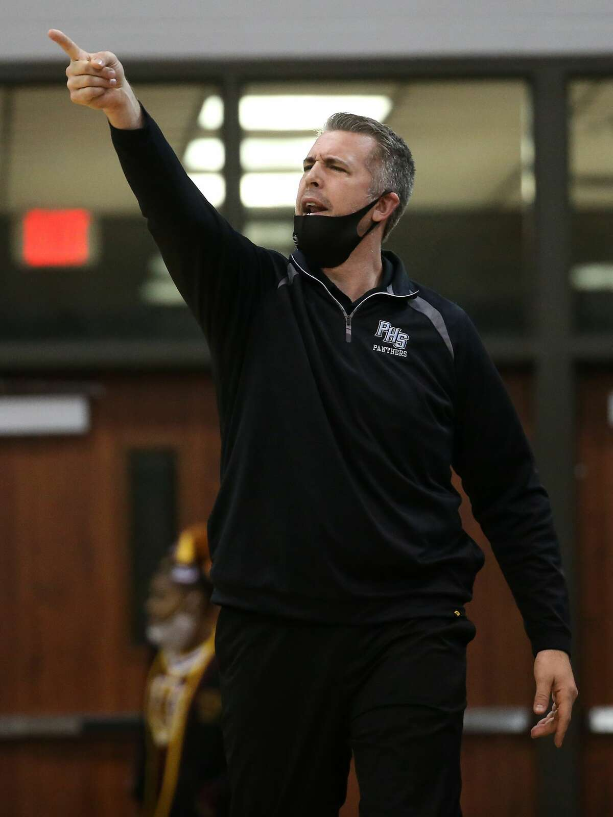 Katy Paetow coach Neimi makes a call from the bench during the first half of the boys Class 5A Region III championship basketball game against Beaumont United at the Campbell Center Friday, March 5, 2021 in Houston.
