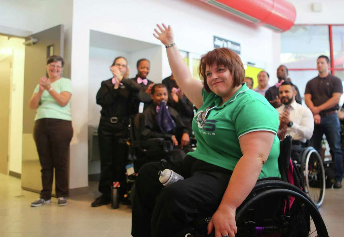 Jazmin Almlie-Ryan, a Paralympic athlete who just returned from competing in the 10-meter air rifle event in Rio, is recognized during a ceremony celebrating the re-opening of the city's Metropolitan Multi-Service Center, Thursday, Sept. 29, 2016, in Houston. Almlie-Ryan now lives in Colorado Springs where she trains at the Olympic Training Center, but she got her start playing basketball at the Multi-Service Center. ( Mark Mulligan / Houston Chronicle )