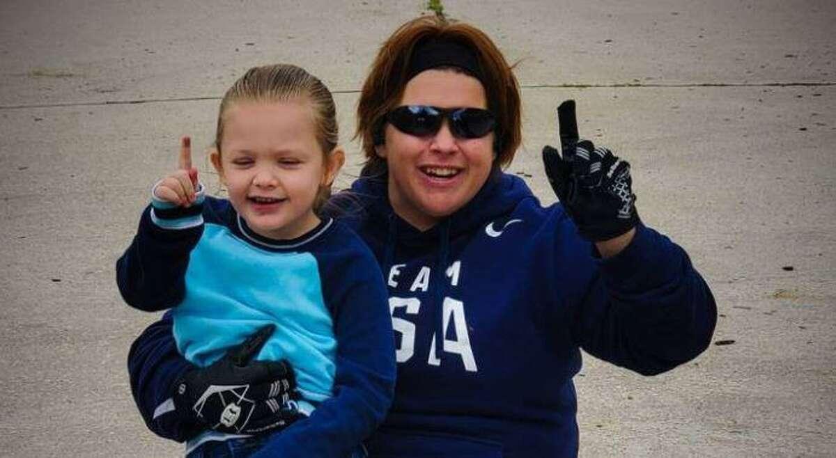 Paralympian Jazmin Almlie-Ryan and her daughter.