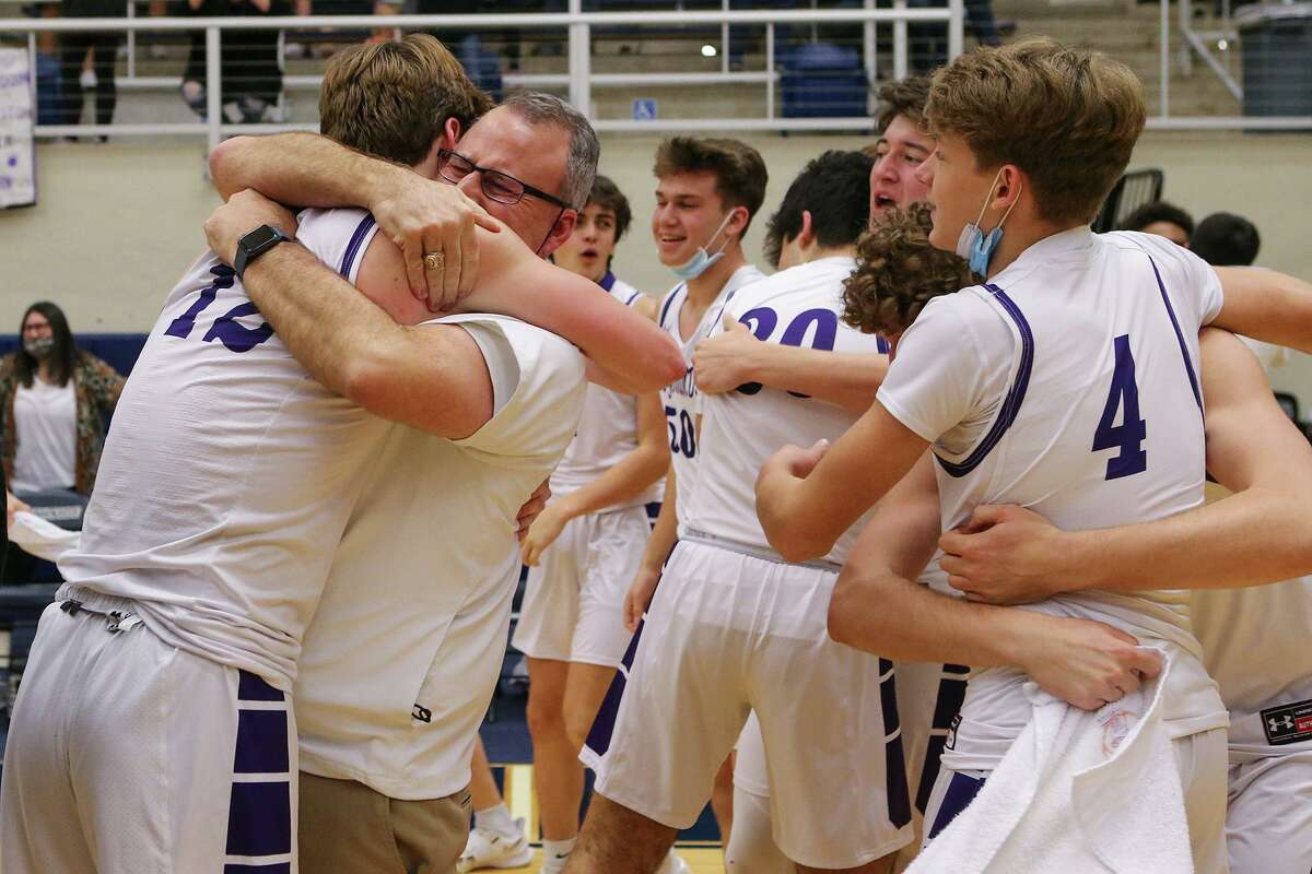 Boerne coach Kimble McHone hugs senior Luke Whidbee, left, as the team celebrates their win over Somerset in the Region IV-4A boys basketball final at Paul Taylor Field House on Friday, March 5, 2021. Boerne beat Somerset 61-59 on a last second shot in regulation.