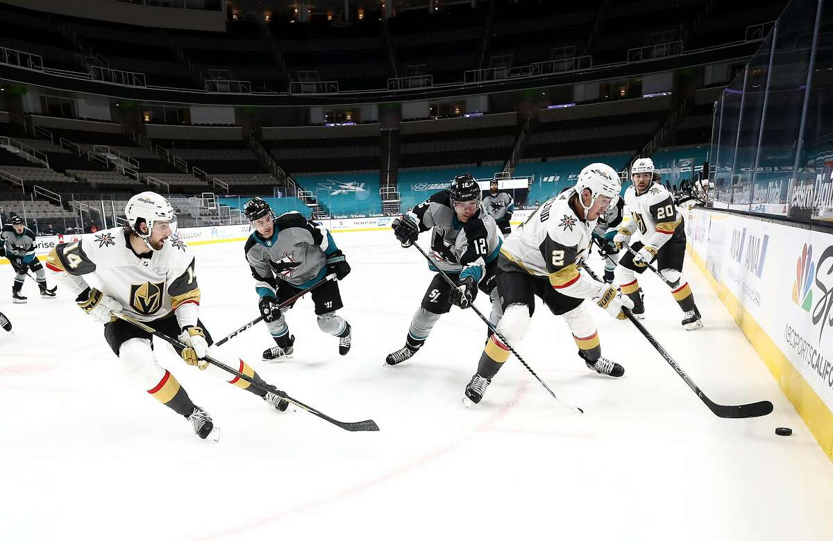 Vegas' Zach Whitecloud controls the puck in front of the Sharks' Patrick Marleau on Friday night in San Jose.