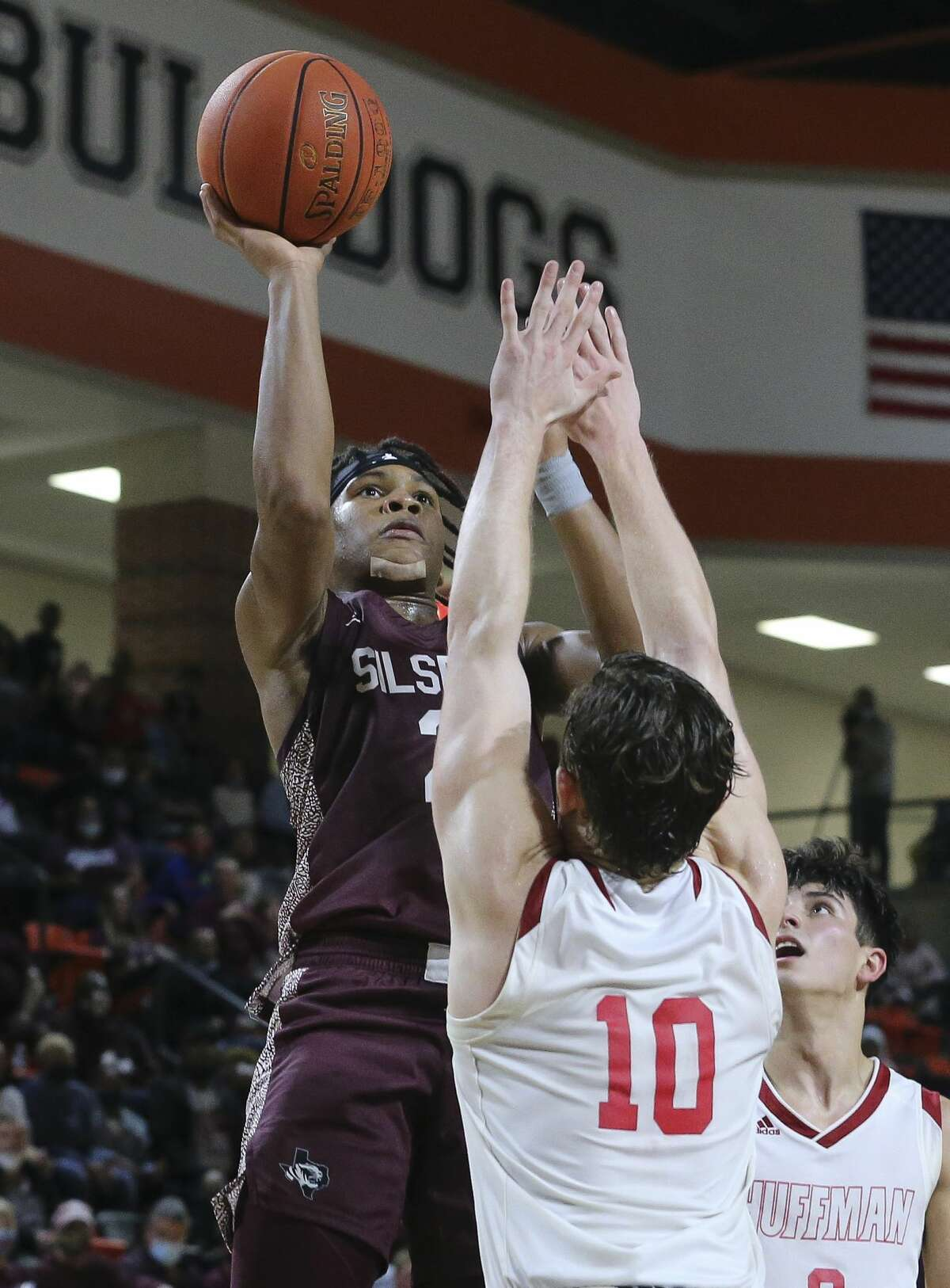 Silsbee Tigers Dre'lon Miller aims for the basket over Huffman Falcons Jacob Harvey during the second half of the 4A Region III championship game Friday, March 5, 2021, at La Porte High School in La Porte. Huffman Falcons defeated Silsbee Tigers 62-56.