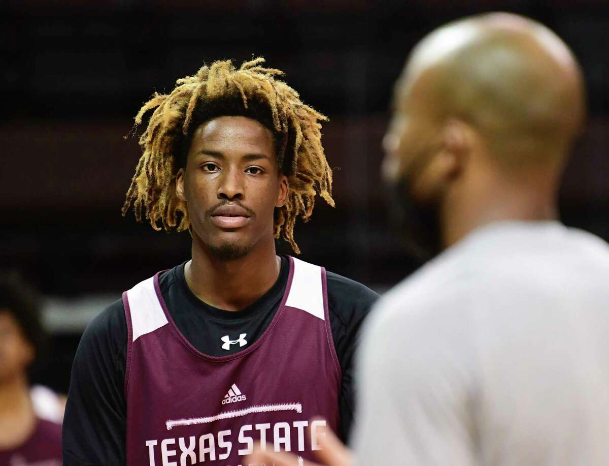 Caleb Asberry lists as coach Terrence Johnson speaks during the Texas State Bobcats' practice at Strahan Arena on Wednesday, March 3, 2021.