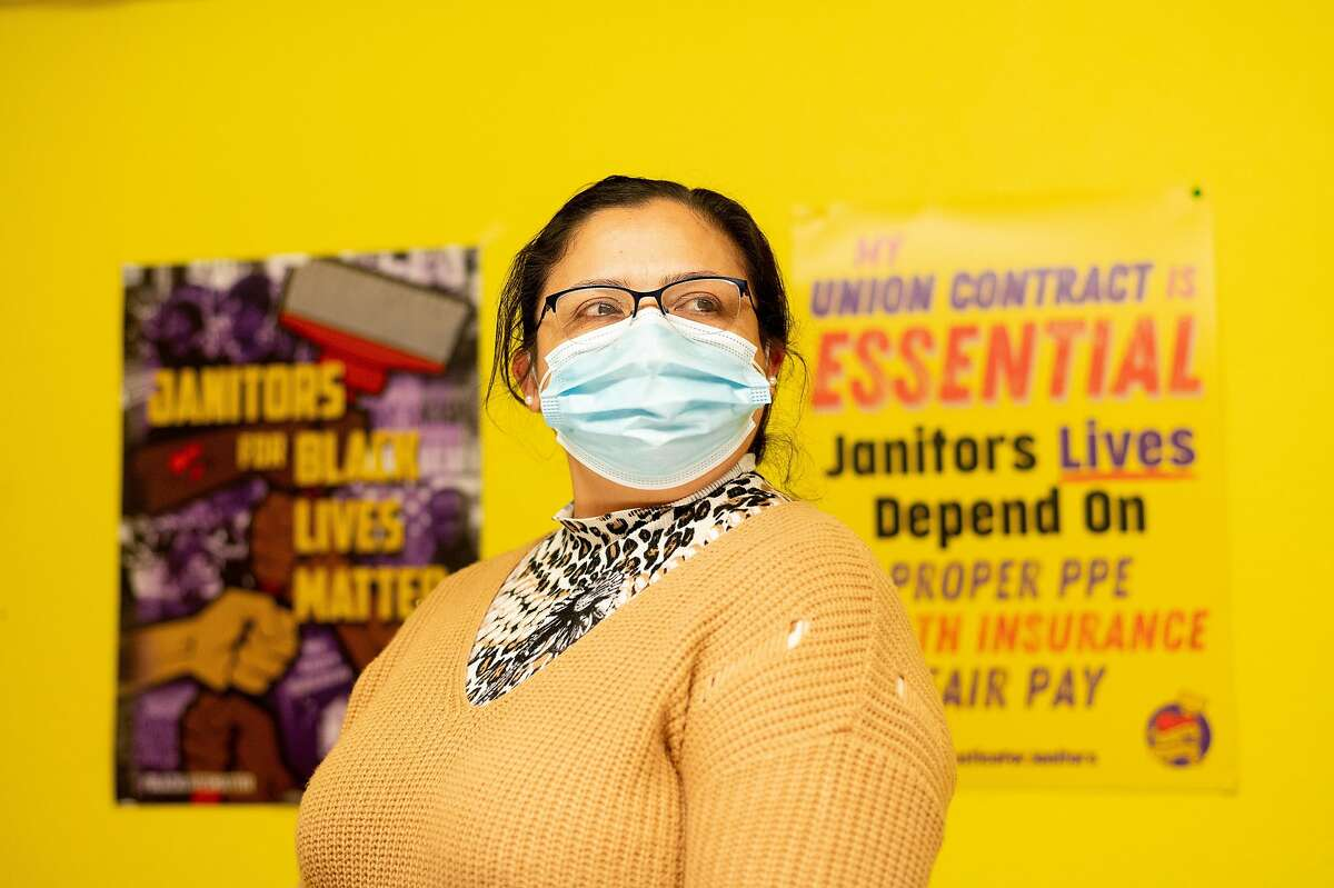 Janitor Gloria Espinoza stands for a portrait at Service Employees International Union (SEIU) Local 87 headquarters on Friday, March 5, 2021, in San Francisco.
