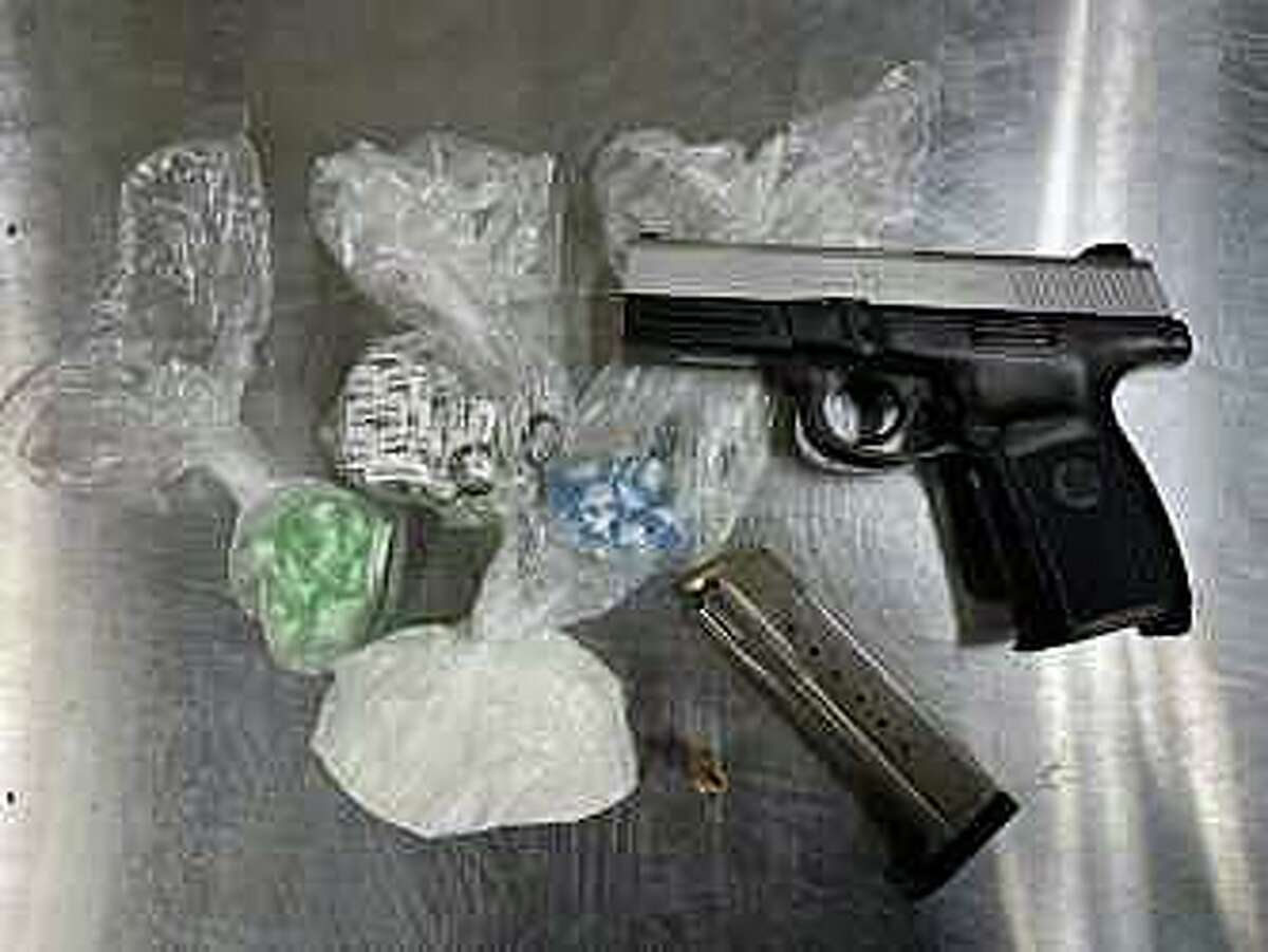 Items seized during an arrest in Meriden, Conn., on Friday, March 5, 2021.