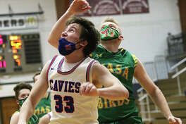 Carlinville's Aaron Wills (33) scored 12 points and helped the Cavaliers to a 60-51victory over Litchfield Friday in Litchfield. He is shown in action earlier this season against Southwestern.