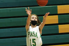 Southwestern's Hannah Nixon, shown shooting a 3-pointer in a game earlier this season in Piasa, made four 3s on Friday night in a SCC win over Vandalia.