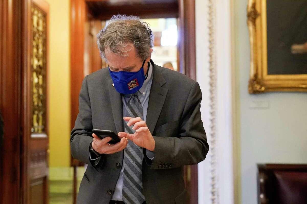 Sen. Sherrod Brown, D-Ohio, walks on Capitol Hill as the Senate works to complete the Democrats' $1.9 trillion COVID-19 relief bill, in Washington, Saturday, March 6, 2021.