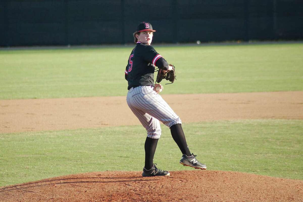 Clear Brook's Cody Myers (5) prepares to deliver a pitch Thursday against Pearland at Clear Brook High School.