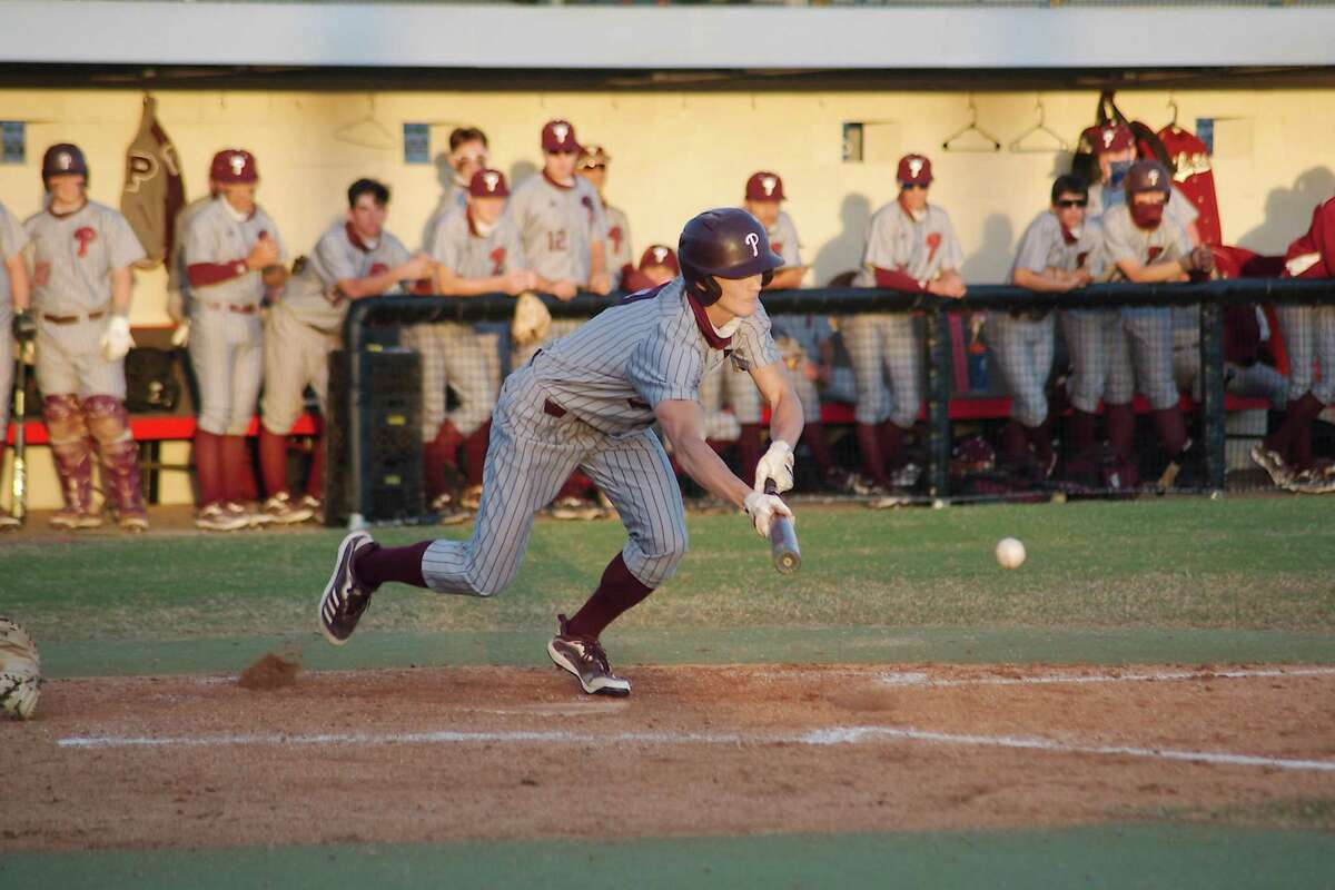 Pearland's Ethan Staley (2) puts down a successful sacrifice bunt against Clear Brook Thursday at Clear Brook High School.