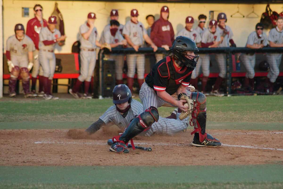 Clear Brook catcher Christian Whitehead, shown against Pearland, had two hits Tuesday night to lead the Wolverines past Brazoswood, 3-2.