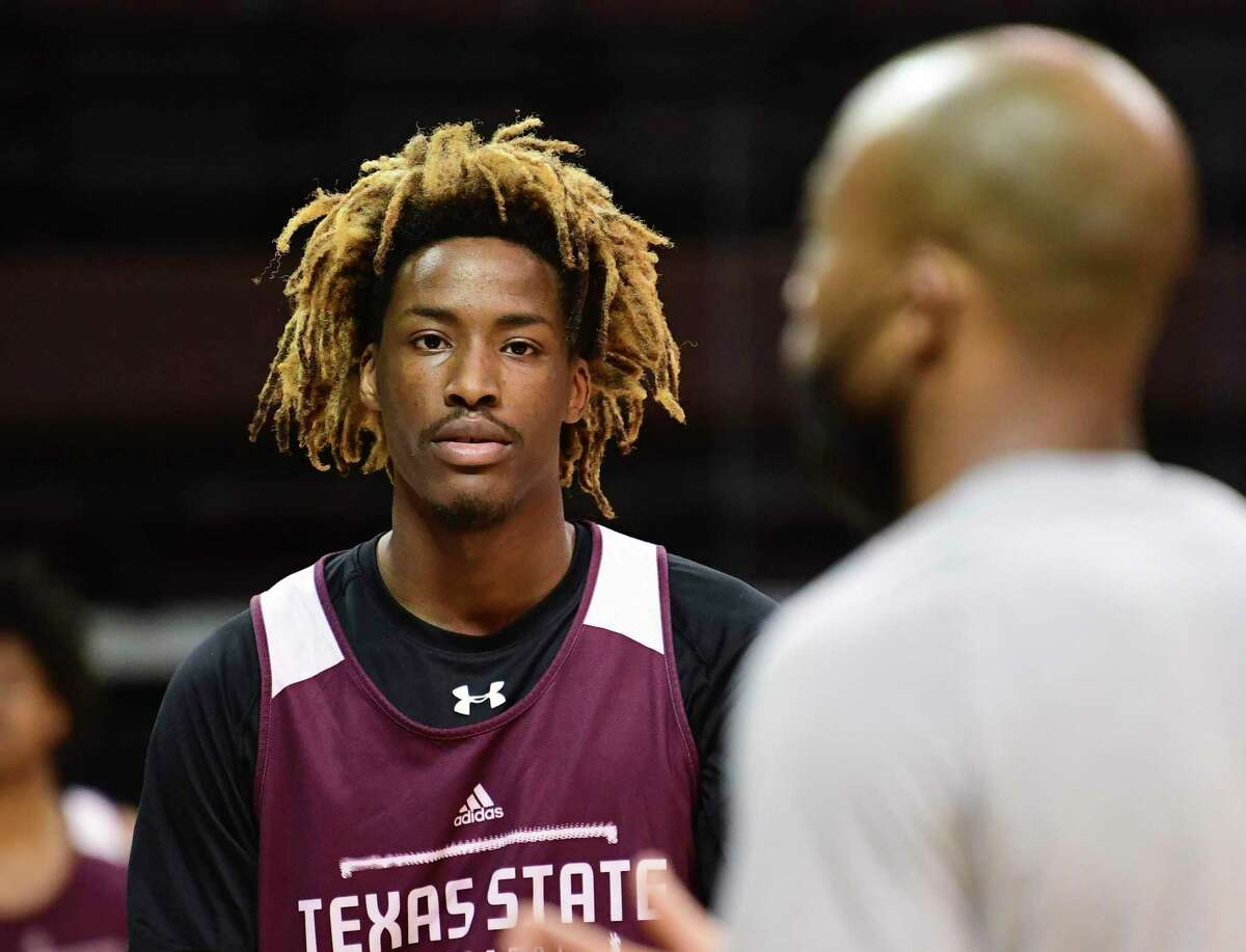 Texas St.'s Caleb Asberry listens to interim coach Terrence Johnson during a recent practice. Johnson took over for Danny Kaspar, who resigned after a university investigation alleged he used racially insensitive comments to players.