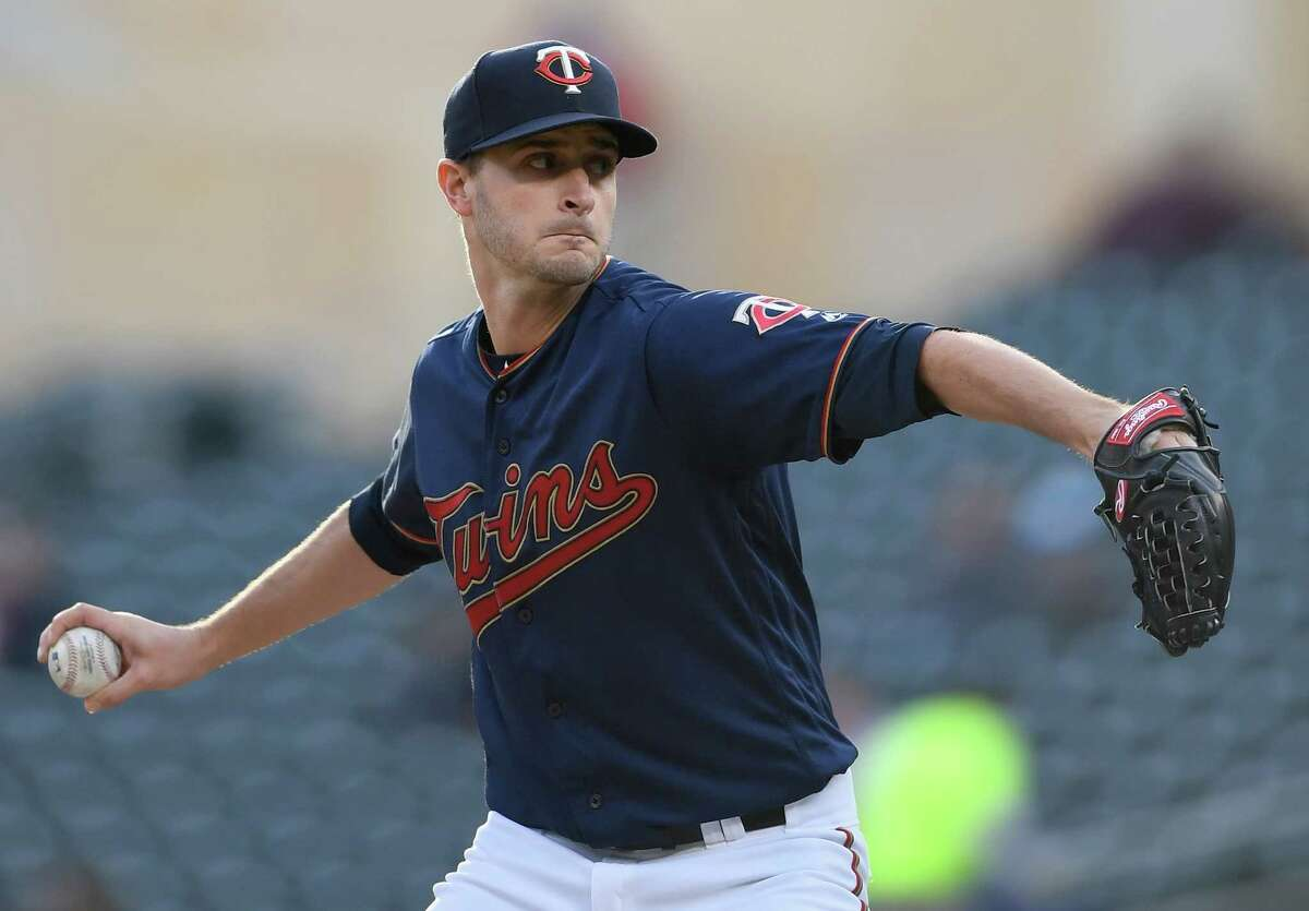 MINNEAPOLIS, MN - APRIL 29: Jake Odorizzi #12 of the Minnesota Twins delivers a pitch against the Houston Astros during the first inning of the game on April 29, 2019 at Target Field in Minneapolis, Minnesota.