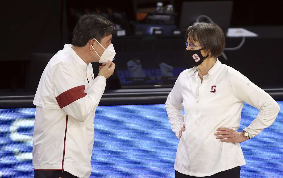 Southern California head coach Mark Trakh, left, and Stanford head coach Tara VanDerveer speak following an NCAA college basketball game in the second round of the Pac-12 women's tournament Thursday, March 4, 2021, in Las Vegas. (AP Photo/Isaac Brekken)