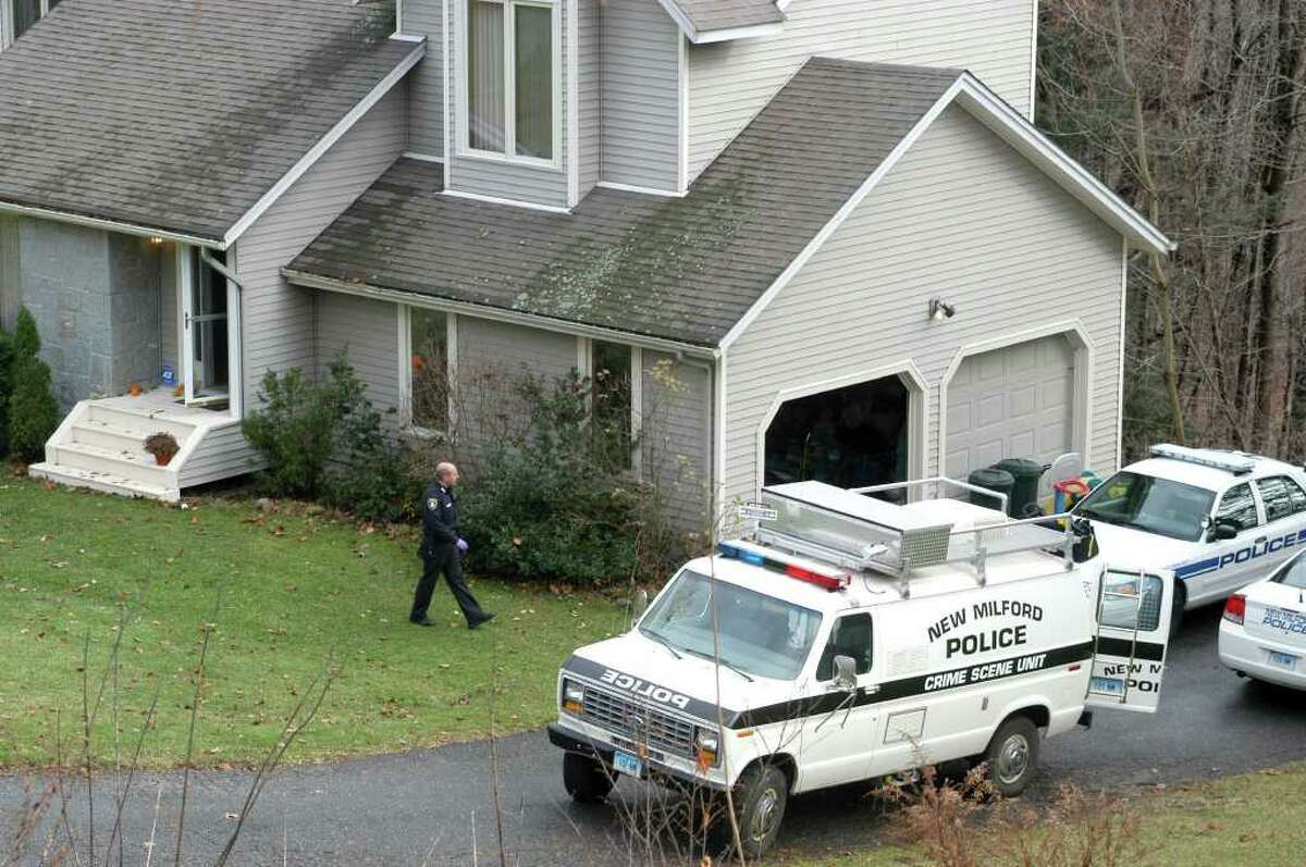 Police work at the home on Cortland Drive in New Milford home where 41-year-old Neil Fergus stabbed his estranged wife and attacked his mother-in-law Saturday afternoon. Catherine Fergus, also 41, was in stable condition at Danbury Hospital Sunday. Neil Fergus will be arraigned in court Monday.