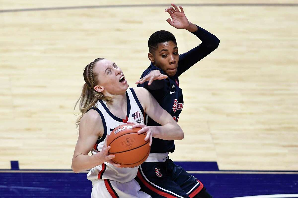 UConn's Paige Bueckers, left, looks to shoot while pressured by St. John's Kadaja Bailey during the first half the Big East tournament quarterfinals at Mohegan Sun Arena on Saturday in Uncasville.