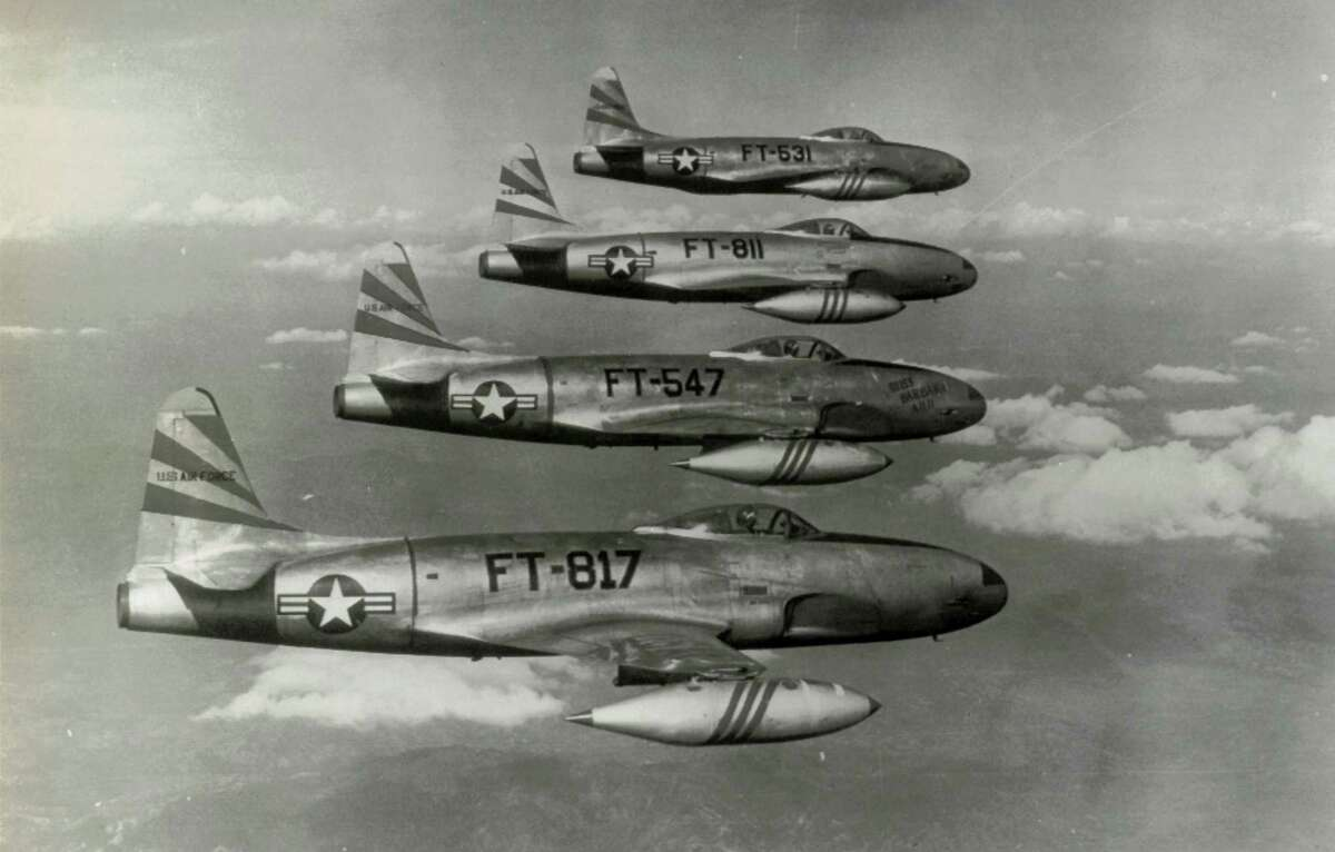 """Airplanes ---- Shooting stars return from battleline strikes -- Precision flying is demonstrated by this flight of F-80 Shooting Stars of the U.S. Eighth Fighter Bomber Wing planes returning to a forward airstrip in Korea from close air support strikes on """"Siberia Hill"""" and """"Bunker Hill"""" areas. These jet fighter bombers returned to their base shortly after this photo was taken, reloaded their bomb racks, rocket launchers and machine guns, and returned to fly further strikes against Red positions. (Korea) (Associated Press)"""