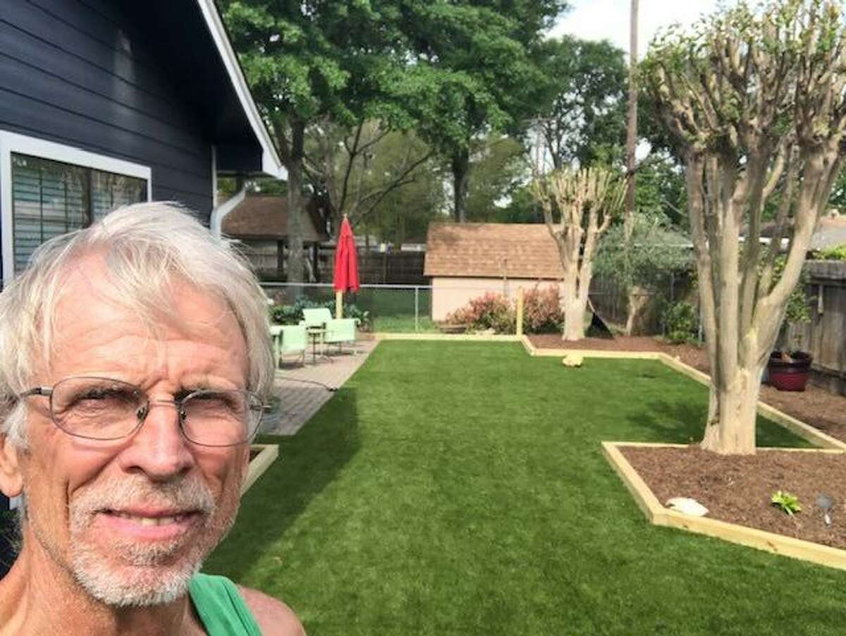 Ron Lohr, owner of Golden Rule Home and Garden, shows off a well-manicured lawn, trees, and shrubs before the winter storm hit.
