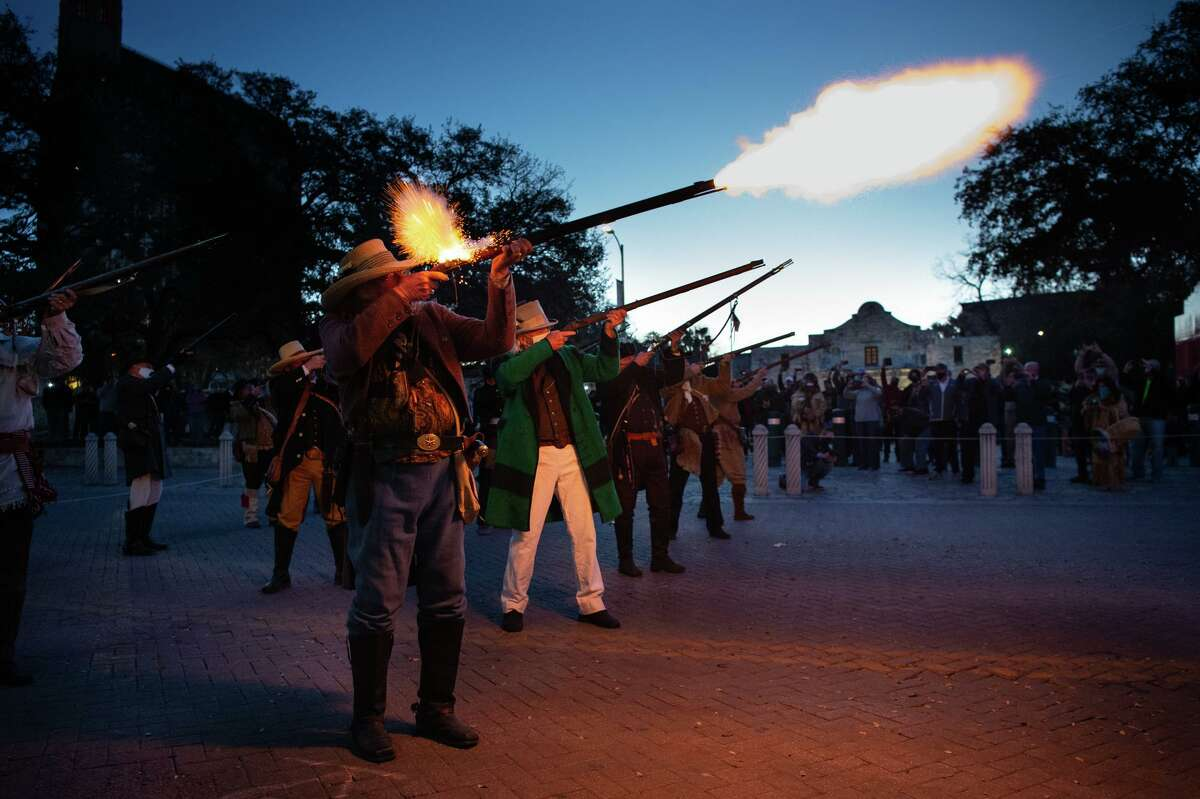 """A musket volley pierces the morning during the """"Dawn at the Alamo"""" ceremony Saturday morning commemorating the beginning of the siege of the Alamo in 1836."""