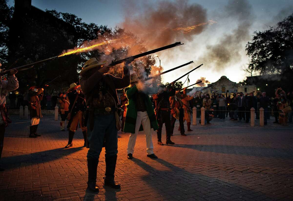 """A musket volley pierces the morning air during the annual """"Dawn at the Alamo"""" ceremony on March 6, 2021. A panel of Alamo scholars recently cautioned against oversimplifying the 1836 battle for Texas independence."""