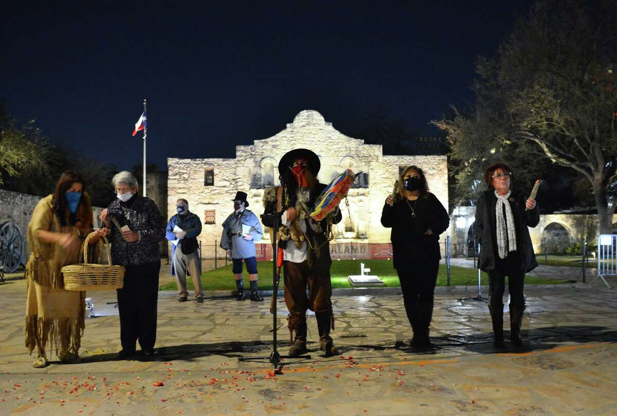 """Ricky Reyes leads a Native American blessing during the """"Dawn at the Alamo"""" ceremony at the Alamo on March 6, the anniversary of the famous battle. A panel of scholars discussed the Alamo's ties to early indigenous people of the area during a forum Tuesday night."""