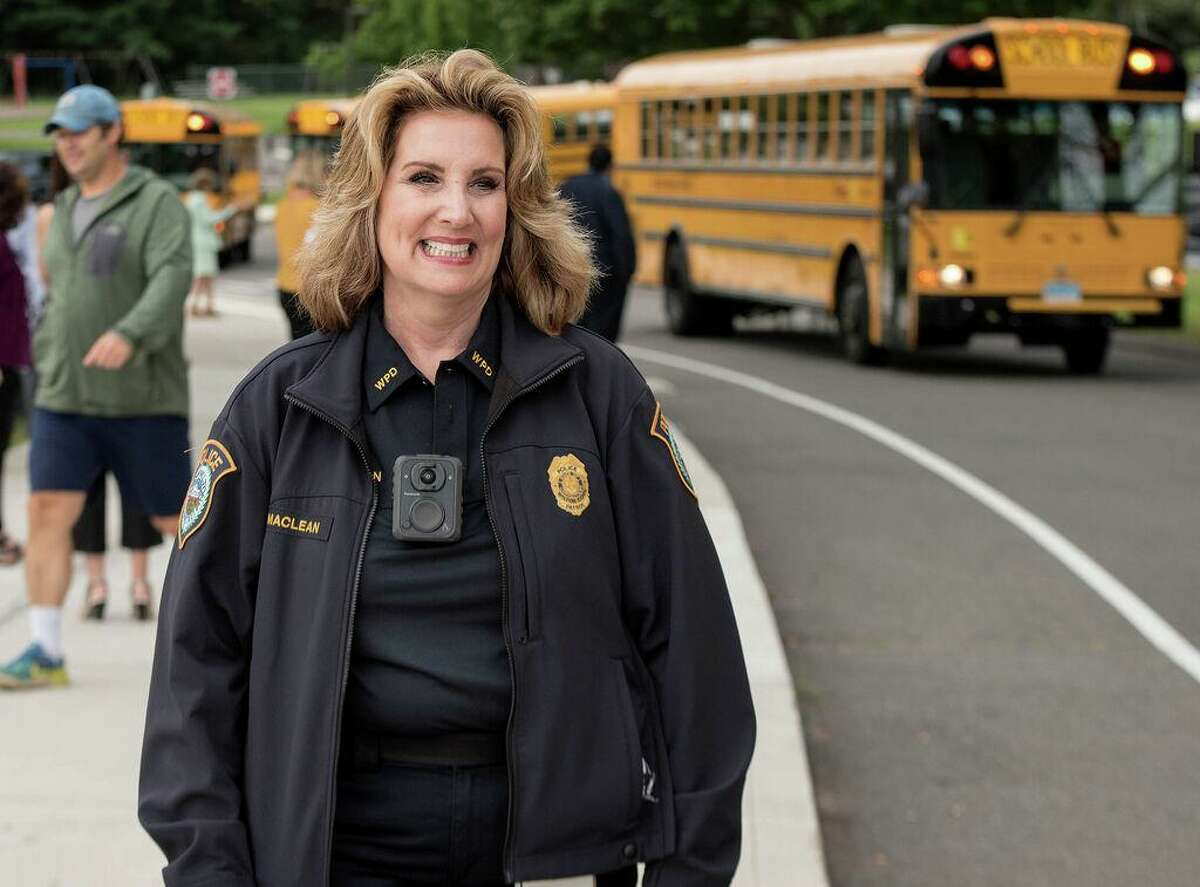 Wilton School Resource Officer Diane Maclean greeted Miller-Driscoll students on the first day of school in 2019 in Wilton, Connecticut.