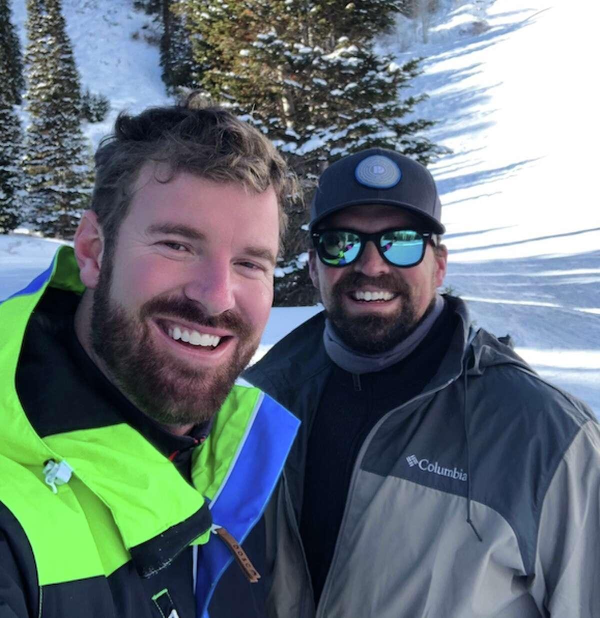 former 'Bachelorette' contestant James McCoy Taylor, left, skiing in Utah on Jan. 7.