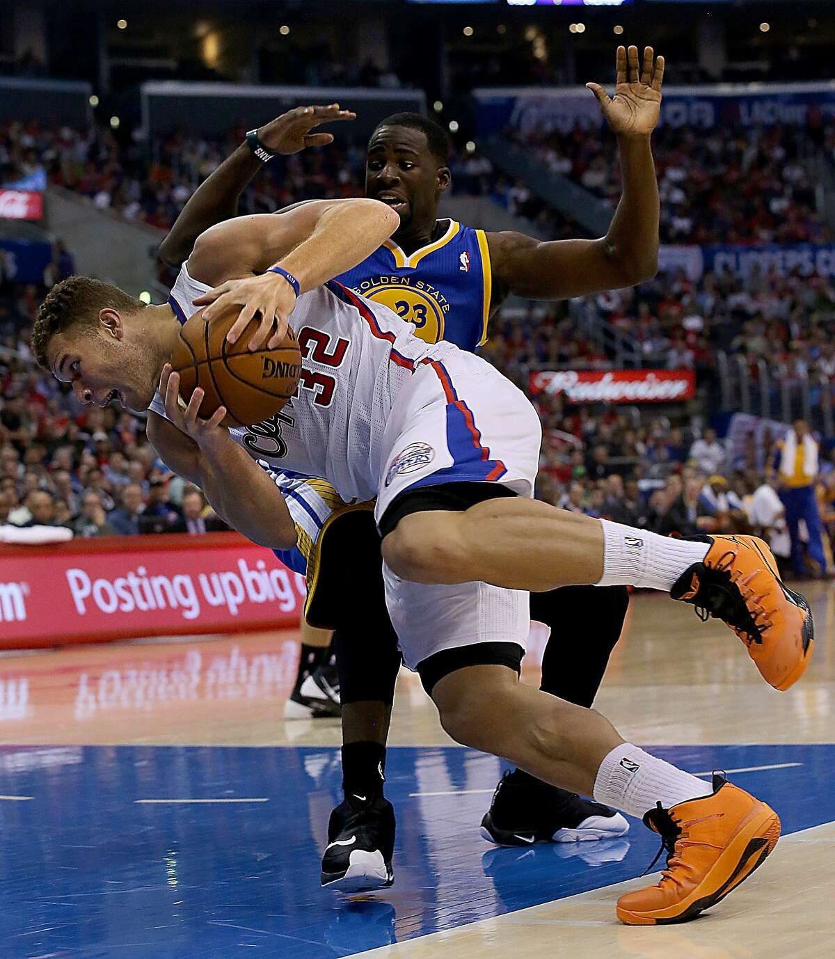 The Los Angeles Clippers' Blake Griffin (32) is tripped up by the Golden State Warriors' Draymond Green in the second quarter at Staples Center in Los Angeles, California, on Thursday, October 31, 2013. (Luis Sinco/Los Angeles Times/MCT)