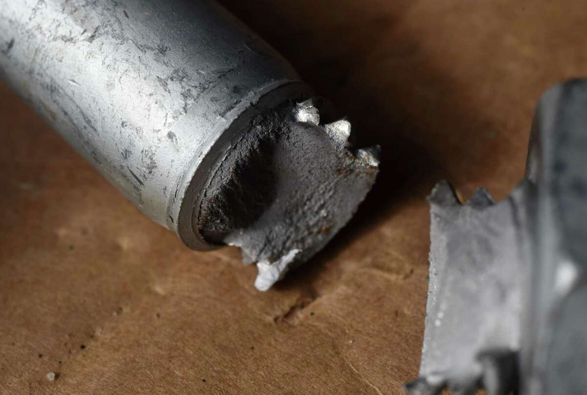 A broken defective bolt used in construction of the Gov Mario M. Cuomo Bridge which snapped during its assembly at the Port of Coeymans is displayed on Saturday, March 6, 2021, in Colonie, N.Y. Some of the high strength bolts would snap under the first stage of torquing. Many were delivered to the job site with cracks already visible in the heads. (Will Waldron/Times Union)