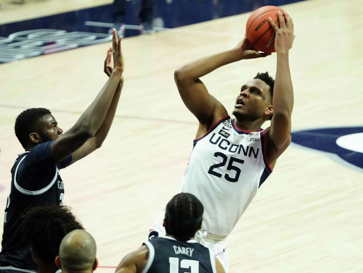 Connecticut forward Josh Carlton (25) shoots against Georgetown in the first half of an NCAA college basketball game Saturday, March 6, 2021, in Storrs, Conn. (David Butler II/Pool Photo via AP)