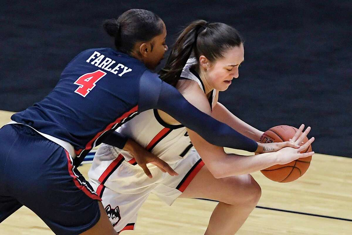 UConn's Nika Mühl, right, steals the ball form St. John's Raven Farley during the first half of the Big East Conference tournament quarterfinals on Saturday at the Mohegan Sun Arena in Uncasville.