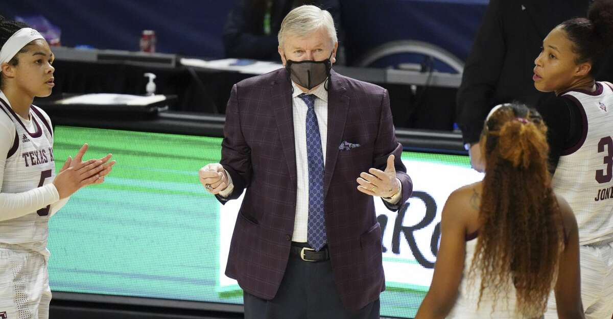 Texas A&M head coach Gary Blair greets players during a timeout in the first half of an NCAA college basketball game against LSU Friday, March 5, 2021, during the Southeastern Conference tournament in Greenville, S.C. (AP Photo/Sean Rayford)