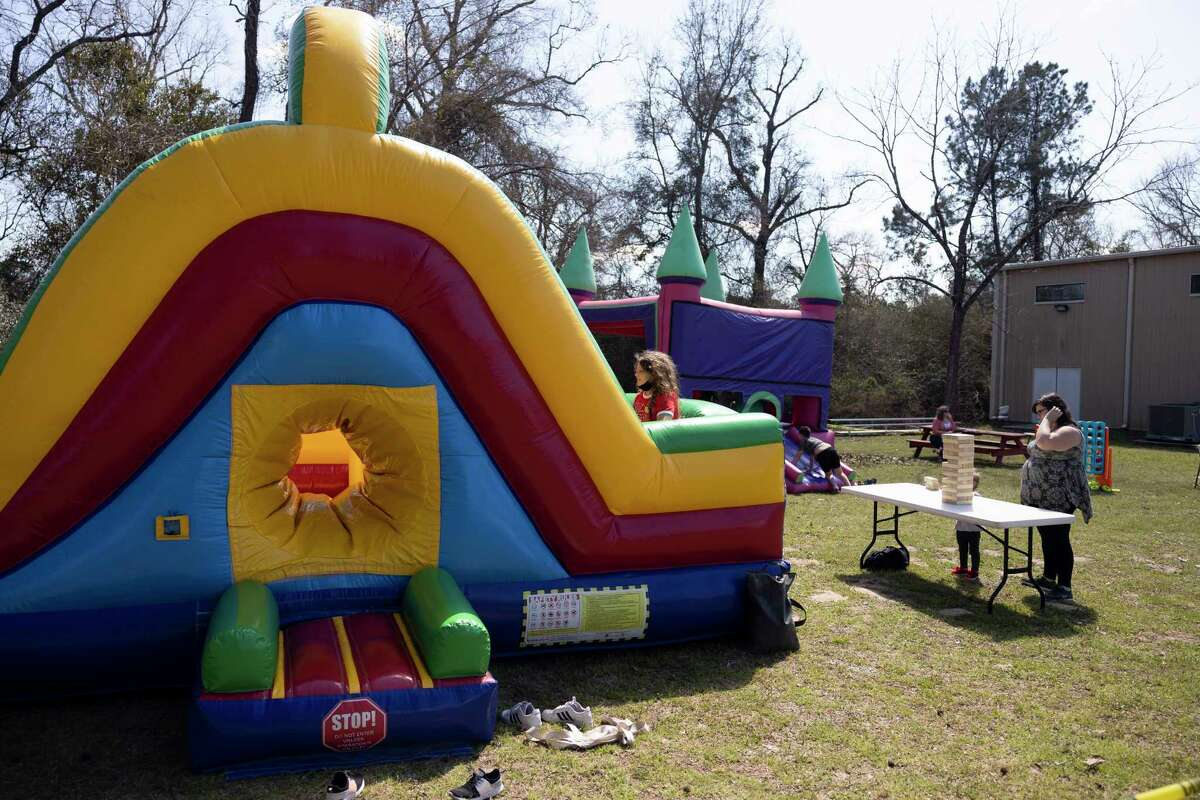 As seen, bounce houses are occupied by children during the inaugural Spring Fever Craft Market, at Bridgewood Farms, Saturday, March 6, 2021, in Conroe. Bridgewood Farms plans to host another event in the fall with hopes to invite more vendors.