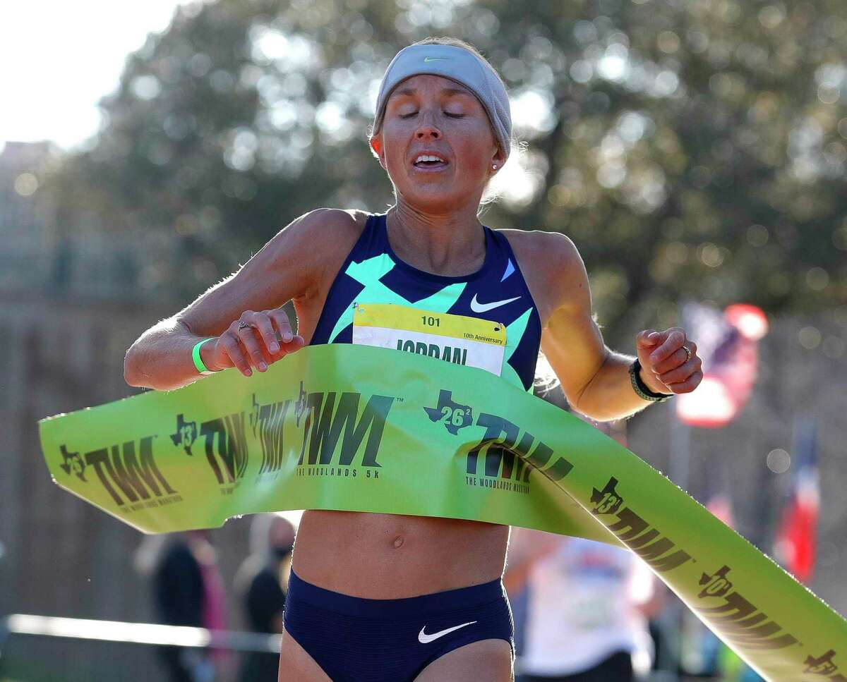 Jordan Hasay reacts as she finishes first in the half marathon portion of The Woodlands Marathon, Saturday, March 6, 2021, in The Woodlands.
