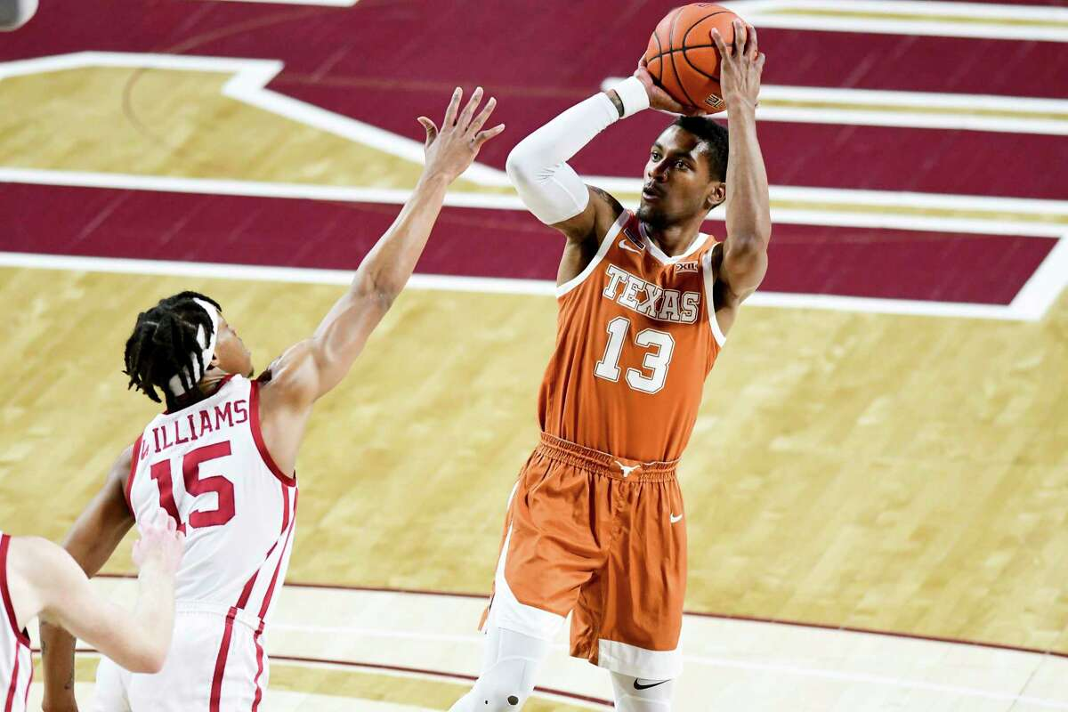 Texas senior guard Jase Febres, right, scored 11 points in 18 minutes in Thursday's 69-65 Big 12 road victory over No. 16 Oklahoma.