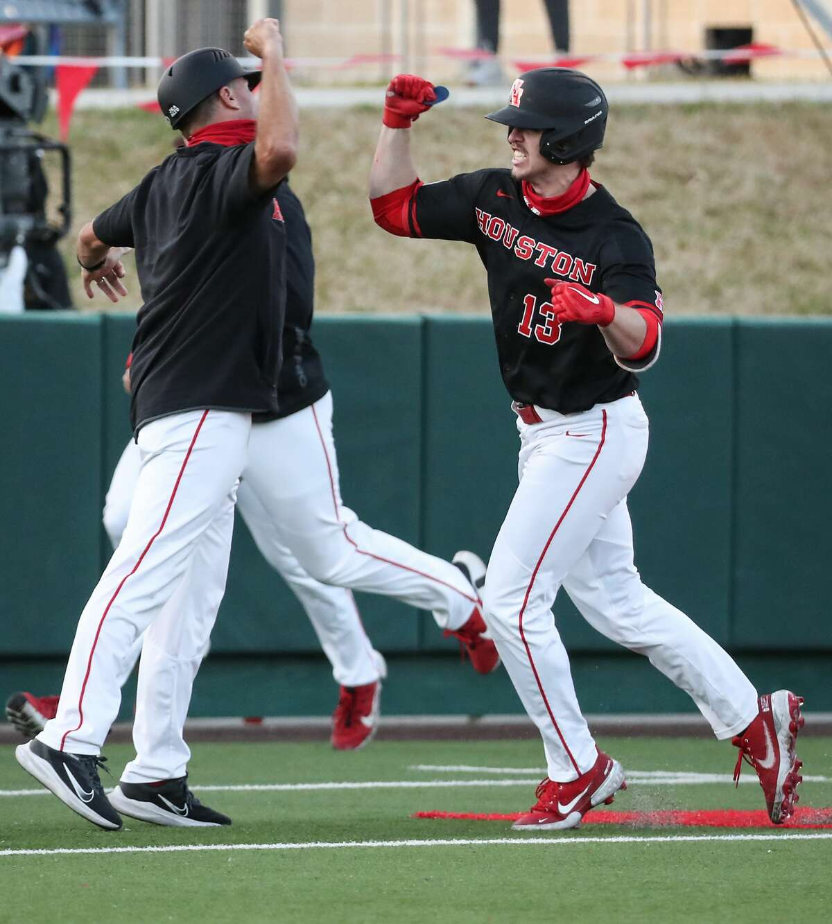 Houston outfielder Tyler Bielamowicz (13) celebrates as he rounds the bases after hitting a walkoff solo home run off Texas reliever Aaron Nixon in the 11th inning of an NCAA college baseball game at Don Sanders Field Saturday, March 6, 2021 in Houston. The Cougars topped the Longhorns 3-2 in 11 innings.