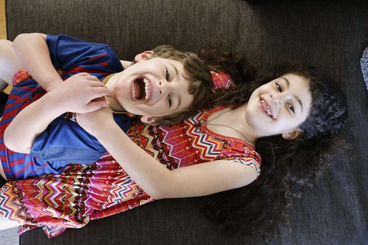 Nate Kajdasz, 5, with sister Bayla, 7, at home in San Francisco.