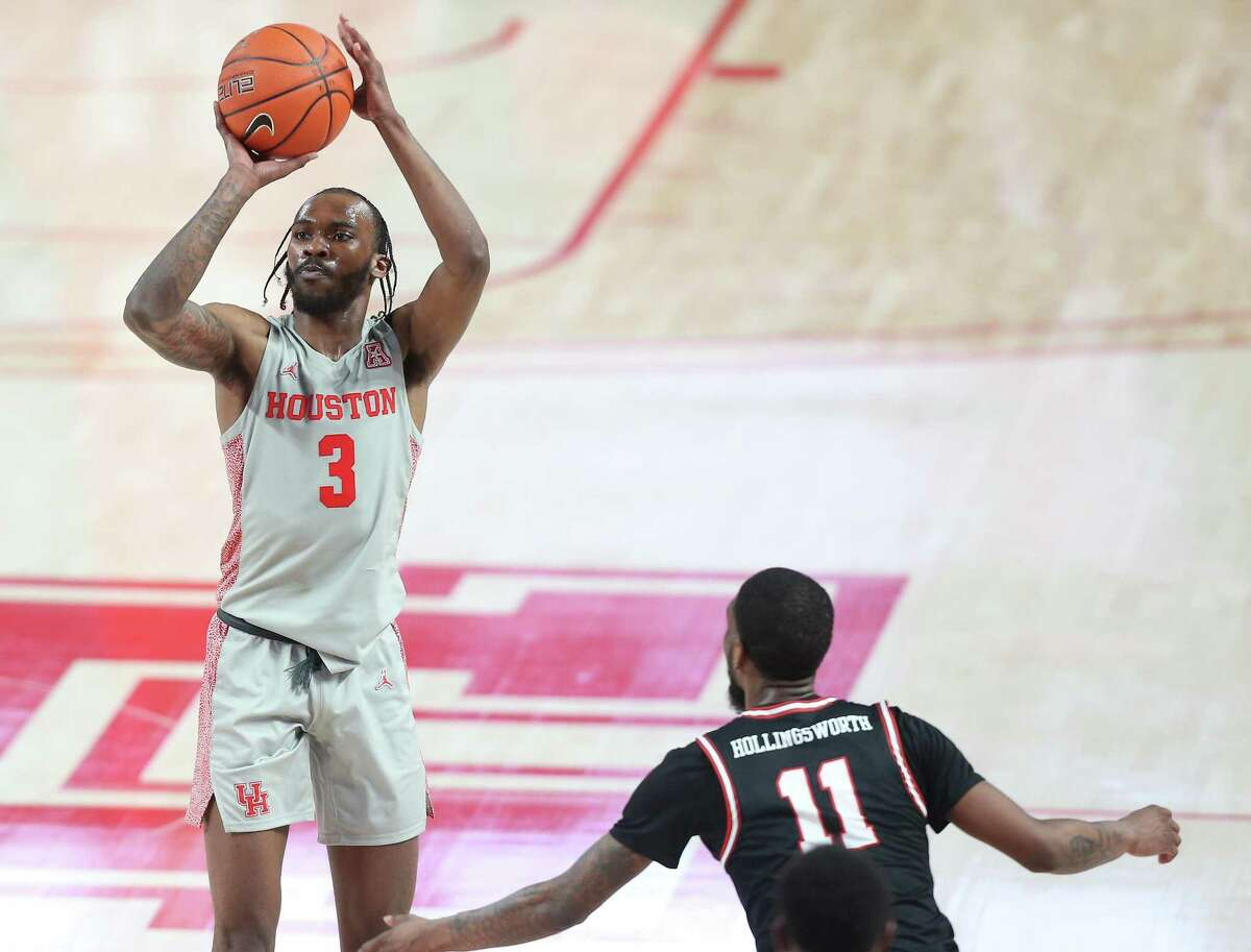 UH guard DeJon Jarreau (3) has a deep connection with teammate Brison Gresham. The two played high school basketball together in New Orleans before playing for the same colleges.