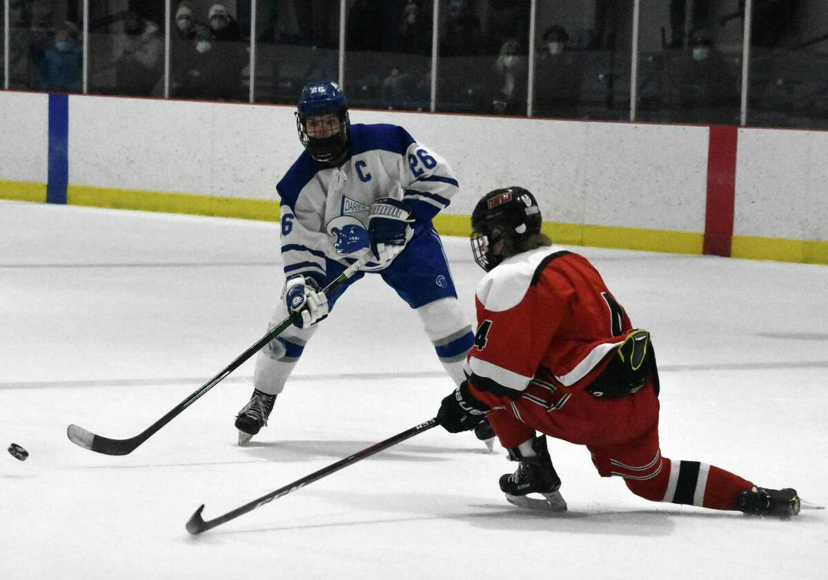 Darien's Luke Johnston makes a pass against the Fairfield co-op at the Darien Ice House on Saturday.
