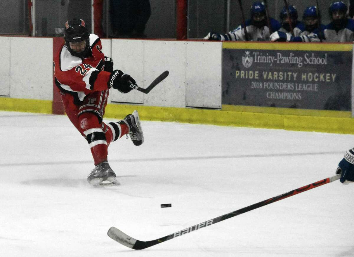 Fairfield co-op's Sam Swanson takes a shot against Darien at the Darien Ice House on March 6, 2021.