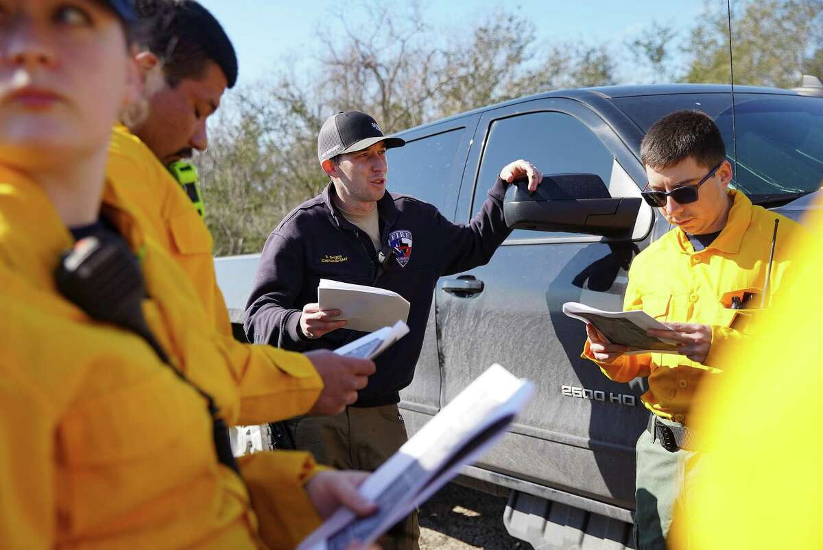 La Marque Fire Dept. Captain Brennan Briggs goes over the incident action plan for a control prairie burn at UH Coastal Center in La Marque on Saturday, March 6, 2021.