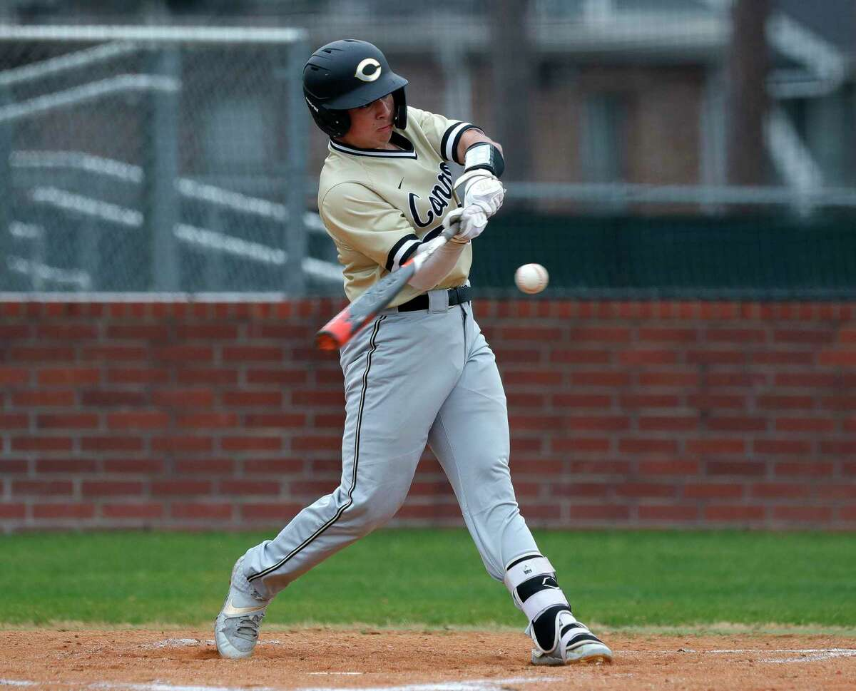 Jackson Todd #21 of Conroe connects for a single in the second inning of a game during the Ferrell Classic at Conroe High School, Friday, March 5, 2021, in Conroe.