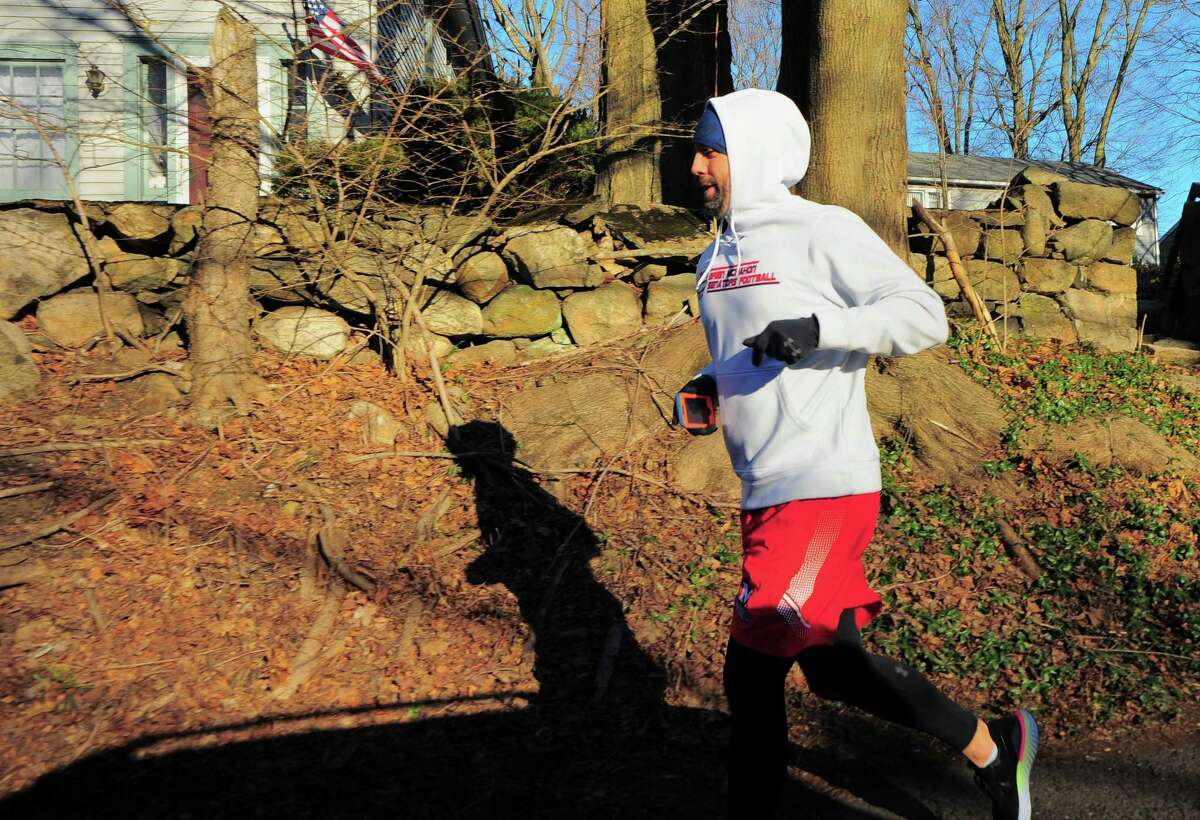 Brien McMahon High School football coach Jeff Queiroga takes part in a 48 miles in 48 hours challenge to raise money for charity in Norwalk, Conn., on Friday Mar. 5, 2021.