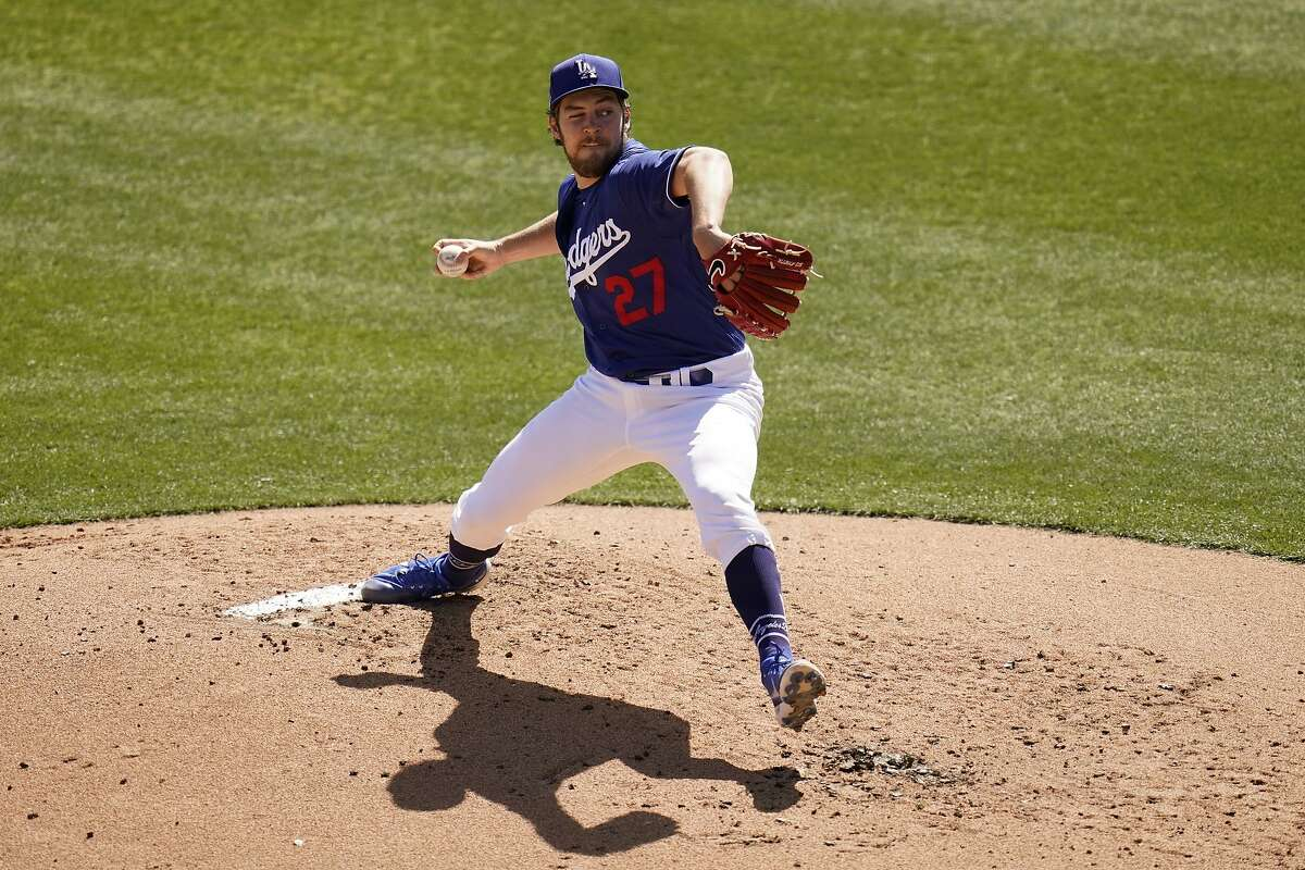 """Dodgers starting pitcher Trevor Bauer pitches with one eye closed against the Padres on Saturday. Bauer said he likes to challenge himself: """"I think that's how you improve."""""""