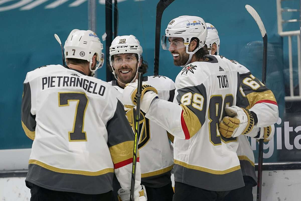 Vegas right wing Alex Tuch (89) celebrates with teammates after scoring against Sharks during the second period.
