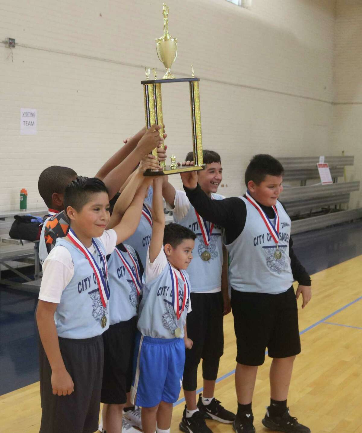 The Thunder celebrate their city championship in the 9 and 10s division Saturday, following a hard-fought 17-14 win at PAL Gym.