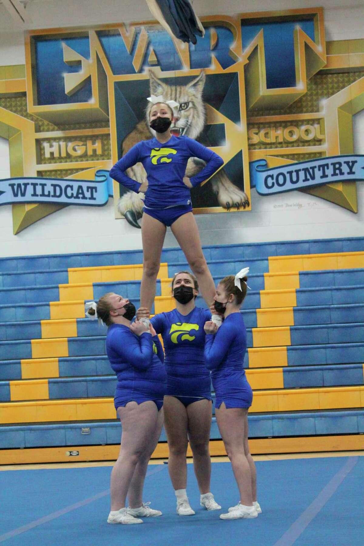 Evart cheerleaders work on their round three during Saturday's cheer meet. (Pioneer photo/John Raffel)