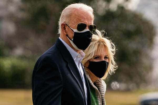 President Joe Biden and first lady Jill Biden walk to Marine One on the South Lawn of the White House on Feb. 26.