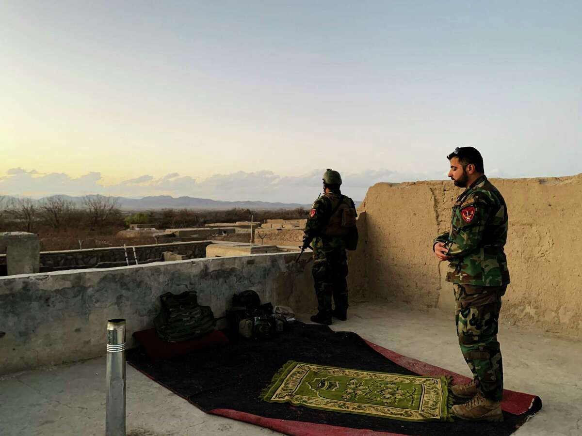 Gen. Haibatullah Alizai, the commander of Afghanistan's Special Operations Corps, prays at the Arghandab outpost. In the valley below, his men were pushing back the Taliban, but with less U.S. air support, progress was slow.