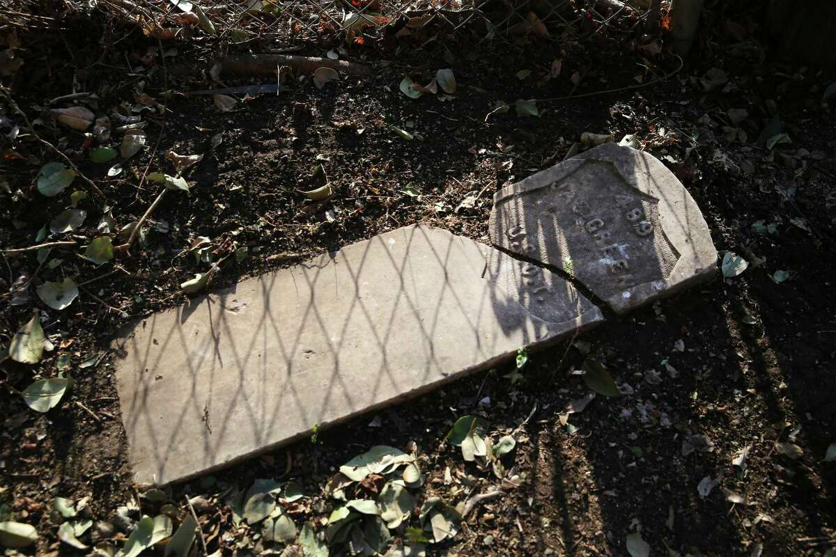 The sun and a nearby fence cast shadows on a headstone that once marked the grave of James Green, a Civil War-era soldier who also served with the famed Buffalo Soldiers infantry and later moved to San Antonio, where he died in 1917. The headstone was discovered at the home of Tommie Hinton Jr. on the city's East Side.